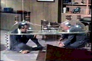 Maxwell Smart (Don Adams) and The Chief (Edward Platt) once again futilely use the Cone of Silence.