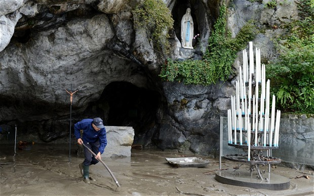 A massive clean-up was under way on Sunday in the French pilgrimage town of Lourdes, famed for its Catholic sanctuaries, after flash floods forced the evacuation of some 450 pilgrims and closed the main shrine.
