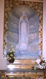 Statue of Our Lady of the Globe above casket with incorrupt body of St Catherine Labouré (Donal Foley)